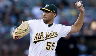 Oakland Athletics starting pitcher Sean Manaea throws to a Boston Red Sox batter during the first inning of a baseball game in Oakland, Calif., Saturday, April 21, 2018. (AP Photo/John Hefti)