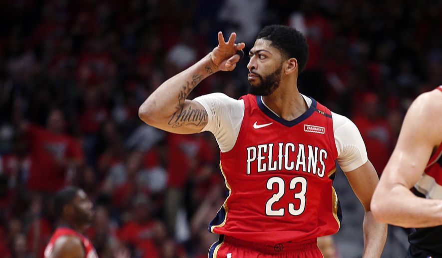 New Orleans Pelicans forward Anthony Davis reacts after making a 3-point shot during the first half of Game 4 of the team's first-round NBA basketball playoff series against the Portland Trail Blazers in New Orleans, Saturday, April 21, 2018. (AP Photo/Scott Threlkeld)