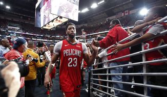 New Orleans Pelicans forward Anthony Davis (23) greets fans after defeating the Portland Trail Blazers in Game 4 of a first-round NBA basketball playoff series in New Orleans, Saturday, April 21, 2018. (AP Photo/Scott Threlkeld)