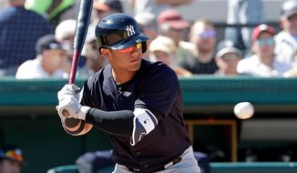 FILE - In this March 6, 2018, file photo, New York Yankees' Gleyber Torres bats against the Detroit Tigers in a spring baseball exhibition game in Lakeland, Fla. Top prospect Torres is being called up to the Yankees, a person familiar with the decision told The Associated Press. The 21-year-old infielder will join the Yankees before Sunday's game against the Toronto Blue Jays, the person said Saturday, April 21, 2018, speaking on condition of anonymity because the decision had not been announced. (AP Photo/John Raoux, File)