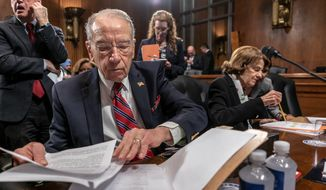 Judiciary Committee Chairman Chuck Grassley, Iowa Republican, refused to postpone a nomination hearing Wednesday while the Senate is in recess. He said Sen. Dianne Feinstein (right) of California, the committee's top Democrat, had agreed to that date after requesting three other delays. (Associated Press/File)