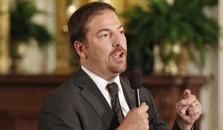Chuck Todd, chief White House correspondent for NBC News, speaks on camera before President Barack Obama and British Prime Minister David Cameron hold a joint news conference in the East Room of the White House in Washington, Tuesday, July 20, 2010. (AP Photo/Charles Dharapak)