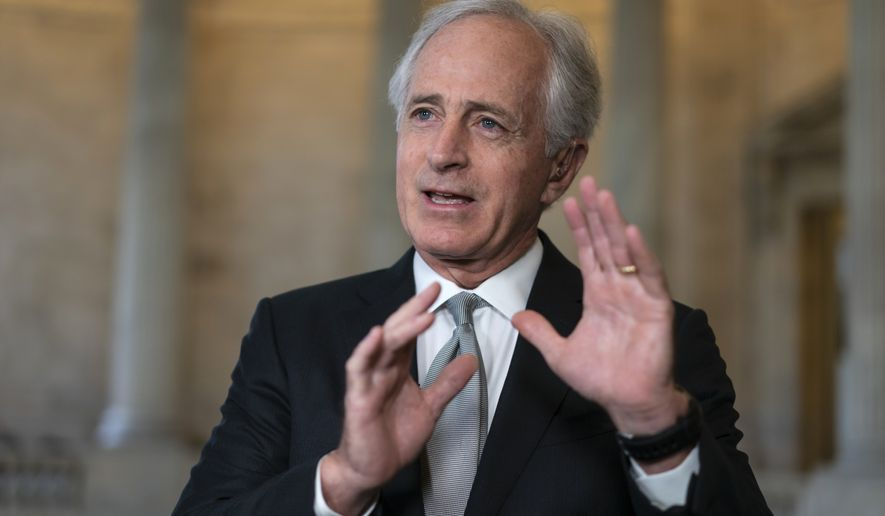 Senate Foreign Relations Committee Chairman Bob Corker, R-Tenn., takes questions during a TV news interview on Capitol Hill in Washington, Thursday, April 19, 2018. CIA Director Mike Pompeo's nomination for secretary of state has so divided the Foreign Relations Committee that it might send his nomination to the full Senate without a favorable recommendation. (AP Photo/J. Scott Applewhite)