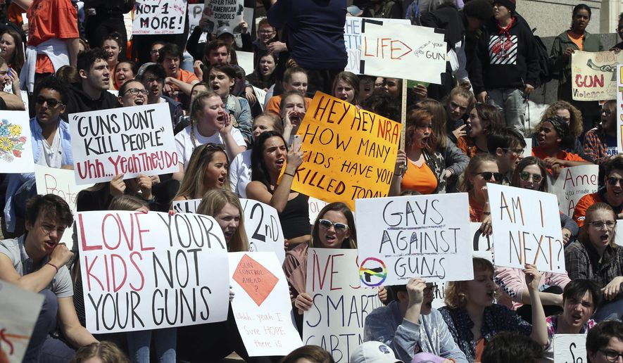 Hundreds of students gathered Friday, April 20, 2018, at the State Capitol in St. Paul, Minn., to protest gun violence, part of a national high school walkout on the 19th anniversary of the Columbine shootings. (AP Photo/Jim Mone) ** FILE **