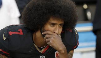 San Francisco 49ers quarterback Colin Kaepernick (7) kneels during the national anthem before an NFL football game against the Arizona Cardinals in Santa Clara, Calif., Thursday, Oct. 6, 2016. (AP Photo/Marcio Jose Sanchez)