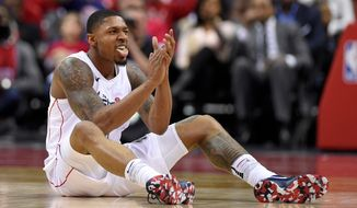 Washington Wizards guard Bradley Beal (3) reacts after he was fouled during the second half of Game 4 of an NBA basketball first-round playoff series against the Toronto Raptors, Sunday, April 22, 2018, in Washington.(AP Photo/Nick Wass)