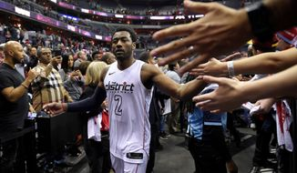 Washington Wizards guard John Wall (2) greets fans after Game 4 of an NBA basketball first-round playoff series against the Toronto Raptors, Sunday, April 22, 2018, in Washington. (AP Photo/Nick Wass)