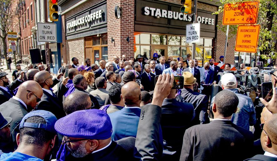 Omega Psi Phi Fraternity members rally, Sunday, April 22, 2018, outside the Starbucks where one of their fraternity brothers was one of the two black men arrested on April 12 for trespassing. (Tom Gralish/The Philadelphia Inquirer via AP)