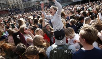 Fans of DJ Avicii gather at Sergels Torg following the news of his death, in central Stockholm, Sweden, Saturday, April 21, 2018. Avicii, the Grammy-nominated electronic dance DJ who performed sold-out concerts for feverish fans around the world and also had massive success on U.S. pop radio, died Friday. He was 28.(Fredrik Persson/TT New Agency via AP)