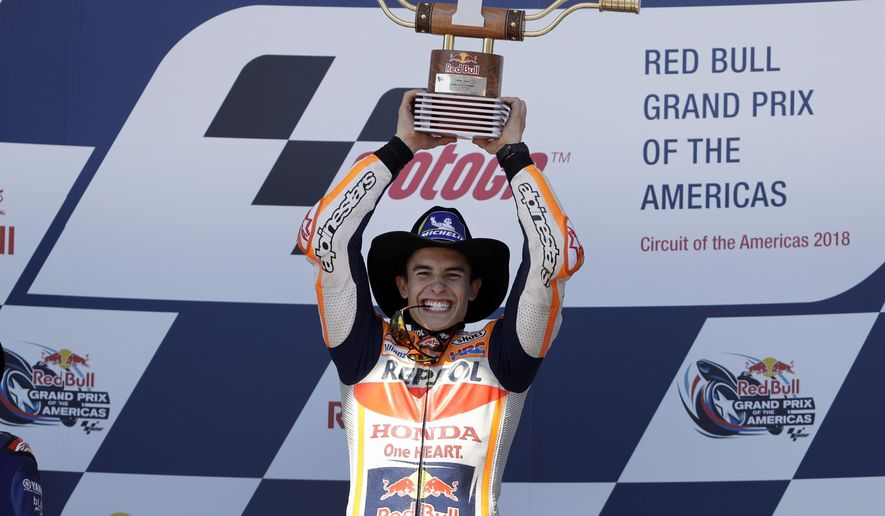 Marc Marquez (93) of Spain celebrates his win in the Grand Prix of the Americas motorcycle race at the Circuit Of The Americas in Austin, Texas, Sunday, April 22, 2018. (AP Photo/Eric Gay)