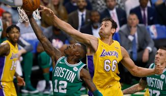 FILE - In this Nov. 8, 2017 file photo, Boston Celtics' Terry Rozier (12) goes to the basket past Los Angeles Lakers' Andrew Bogut during the first quarter of an NBA basketball game in Boston. NBA veteran Andrew Bogut is set to join the Sydney Kings in Australia's National Basketball League. The Sydney club issued a brief statement Monday, April 23, 2018 saying it had submitted paperwork to the NBL for Bogut's recruitment.(AP Photo/Winslow Townson,File)