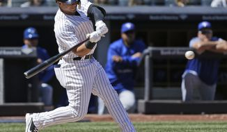 New York Yankees' Gleyber Torres hits into a double play during the fourth inning of a baseball game against the Toronto Blue Jays at Yankee Stadium, Sunday, April 22, 2018, in New York. (AP Photo/Seth Wenig)