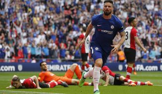 Chelsea's Olivier Giroud celebrates after scoring his side opening goal during the English FA Cup semifinal soccer match between Chelsea and Southampton at the Wembley stadium in London, Sunday, April 22, 2018. (AP Photo/Frank Augstein)