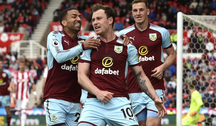 Burnley's Ashley Barnes, celebrates scoring his side's first goal of the game against Stoke City during the English Premier League soccer match at the bet365 Stadium, Stoke, England, Sunday April 22, 2018. (Joe Giddens/PA via AP)