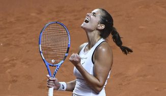 Germany's Julia Goerges  celebrates a point during her match against  Czech Republic's Karolina Pliskova  at the tennis Fed Cup semifinal between Germany and Czech Republic, in Stuttgart, Germany, Sunday, April 22, 2018.  (Marijan Murat/dpa via AP)