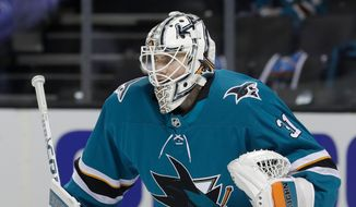 This April 16, 2018 photo shows San Jose Sharks goalie Martin Jones (31) during action against the Anaheim Ducks in the second period of Game 3 of an NHL hockey first-round playoff series in San Jose, Calif. Jones has been the missing ingredient for the Sharks ever since arriving in San Jose three years ago. With Jones in net, the Sharks have gone from a team known for playoff disappointments into one that has had more success this time of year. He led San Jose to the Stanley Cup Final two years ago and was even better during a first-round sweep this year against Anaheim. (AP Photo/Jeff Chiu)