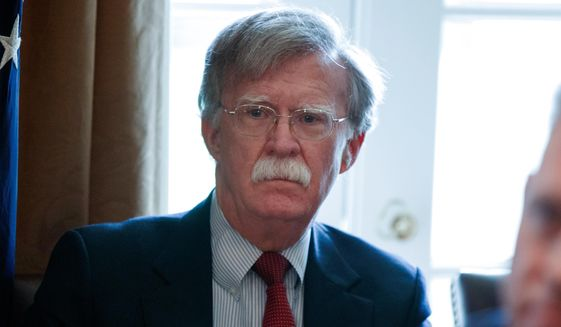 In this April 9, 2018, file photo, National Security Adviser John Bolton listens as President Donald Trump speaks during a Cabinet meeting at the White House in Washington. (AP Photo/Evan Vucci, File)