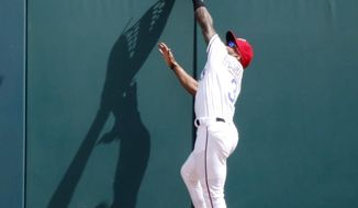 Texas Rangers left fielder Delino DeShields (3) makes a catch to rob Seattle Mariners David Freitas (36) of a home run during the sixth inning of a baseball game Sunday, April 22, 2018, in Arlington, Texas. (AP Photo/Michael Ainsworth)