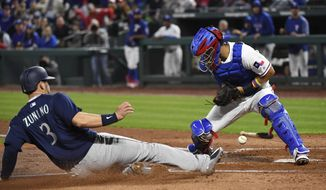 Texas Rangers catcher Robinson Chirinos cannot hold on to the ball as Seattle Mariners' Mike Zunino (3) slides in to score on a single by Dee Gordon during the third inning of a baseball game Saturday, April 21, 2018, in Arlington, Texas. (AP Photo/Jeffrey McWhorter)