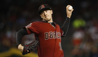 Arizona Diamondbacks starting pitcher Patrick Corbin throws against the San Diego Padres during the first inning of a baseball game Sunday, April 22, 2018, in Phoenix. (AP Photo/Ross D. Franklin)