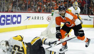 Philadelphia Flyers' Claude Giroux, right, levels Pittsburgh Penguins' Carl Hagelin during the second period in Game 6 of an NHL first-round hockey playoff series Sunday, April 22, 2018, in Philadelphia. (AP Photo/Tom Mihalek)