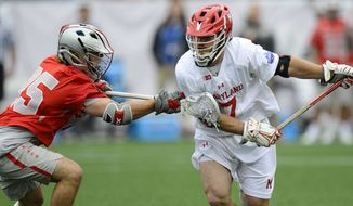 Tim Rotanz (right) of the Maryland lacrosse team plays against Ohio State in a 2017 matchup. (Photo courtesy of Maryland Athletics)