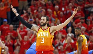 Utah Jazz guard Ricky Rubio (3) reacts after being fouled as he shot a three-point basket against the Oklahoma City Thunder in the first half during Game 3 of an NBA basketball first-round playoff series Saturday, April 21, 2018, in Salt Lake City. (AP Photo/Rick Bowmer)