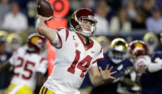 In this Oct. 21, 2017, file photo, Southern California quarterback Sam Darnold throws during the half of an NCAA football game against Notre Dame,  in South Bend, Ind. Darnold is expected top be a first round pick in the NFL Draft. (AP Photo/Carlos Osorio, File)