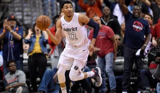 Washington Wizards forward Otto Porter Jr. (22) dribbles the ball during the second half of Game 4 of an NBA basketball first-round playoff series against the Toronto Raptors, Sunday, April 22, 2018, in Washington. The Wizards won 106-98. (AP Photo/Nick Wass) ** FILE **