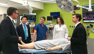 Surgeons at Johns Hopkins University School of Medicine discuss the world's first penis and scrotum transplant in this handout photo. (Image courtesy of the Johns Hopkins University School of Medicine)