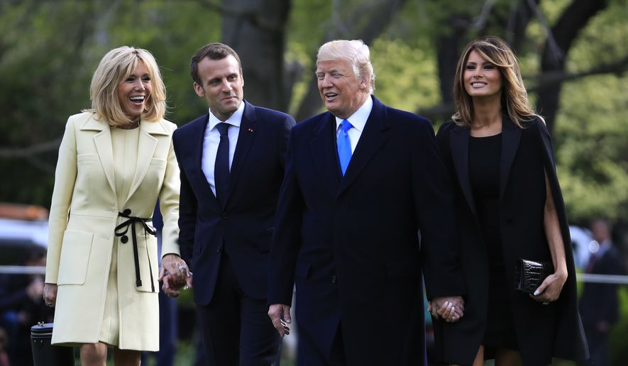 President Donald Trump, first lady Melania Trump, French President Emmanuel Macron and his wife Brigitte Macron, talk as they walk to board a Marine One, following a tree planting ceremony at the White House in Washington, Monday, April 23, 2018. (AP Photo/Manuel Balce Ceneta)