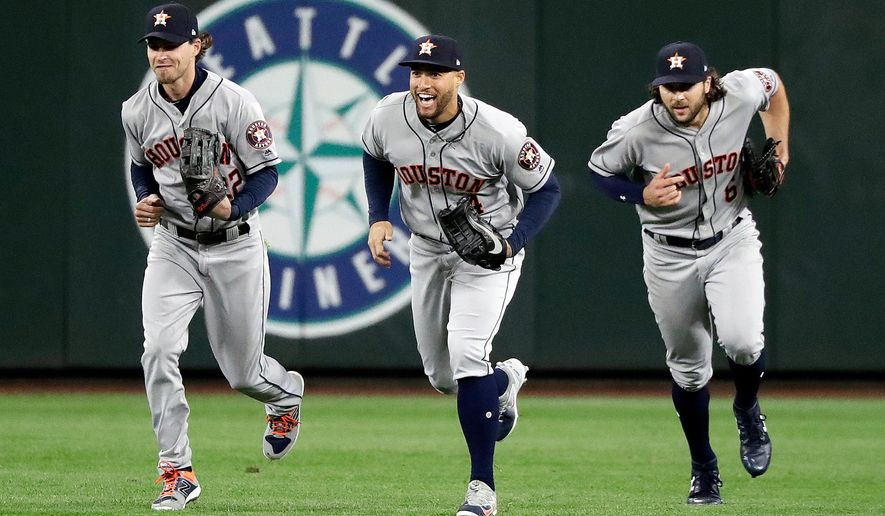 FILE - In this April 17, 2018, file photo, Houston Astros outfielders Josh Reddick, left, George Springer and Jake Marisnick race to the infield after they defeated the Seattle Mariners in a baseball game in Seattle. Houston outfielders have been celebrating victories this season by doing dances inspired by the Fortnite Battle Royale video game. (AP Photo/Elaine Thompson, File)
