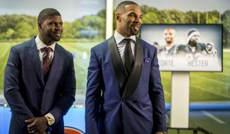 Former Chicago Bears players Devin Hester, left, and Matt Forte attend their retirement ceremony Monday, April 23, 2018 at Halas Hall. Hester hopes to get into the Hall of Fame some day but may soon be part of an extinct breed if the NFL eliminates kick returns as is being suggested. Hester and former Bears multipurpose back Matt Forte officially retired Monday at an emotional ceremony after signing one-day contracts with their first NFL team. (Brian Cassella/Chicago Tribune via AP)