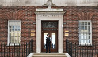 A police officers stands outside the Lindo Wing of St Mary's Hospital in Paddington, London, Monday April 23, 2018. Kate, the Duchess of Cambridge entered a London hospital Monday in labor with a baby who will be a third child for her and husband Prince William and fifth in line to the throne, Britain's royal palace said. (Dominic Lipinski/PA via AP)