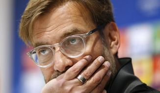 Liverpool manager Jurgen Klopp attends a press conference at Anfield, Liverpool, Britain, Monday, April 23, 2018, on the eve of their Champions League semifinal with AS Roma. (Martin Rickett/PA via AP)