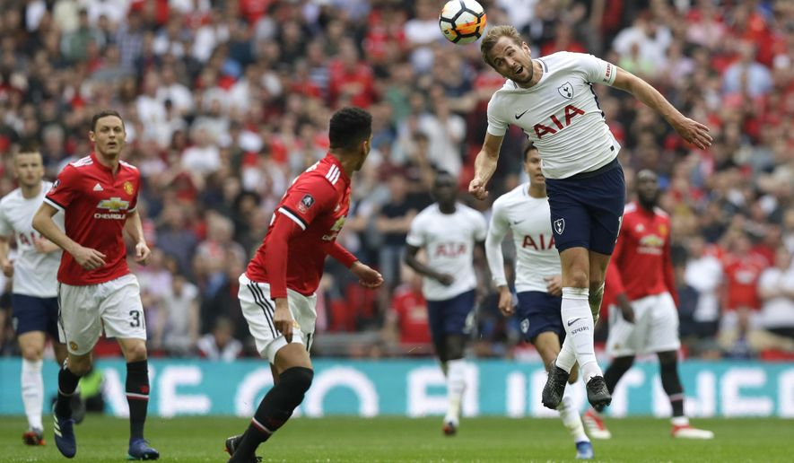 Tottenham's Harry Kane heads the ball during the English FA Cup semifinal soccer match between Manchester United and Tottenham Hotspur at Wembley stadium in London, Saturday, April 21, 2018. (AP Photo/Kirsty Wigglesworth)