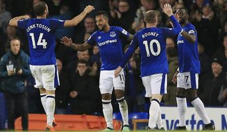 Everton's Theo Walcott, second left, celebrates scoring his side's first goal of the game during the English Premier League soccer match between Everton and Newcastle United at Goodison Park, Liverpool, England, Monday, April 23, 2018. (Peter Byrne/PA via AP)