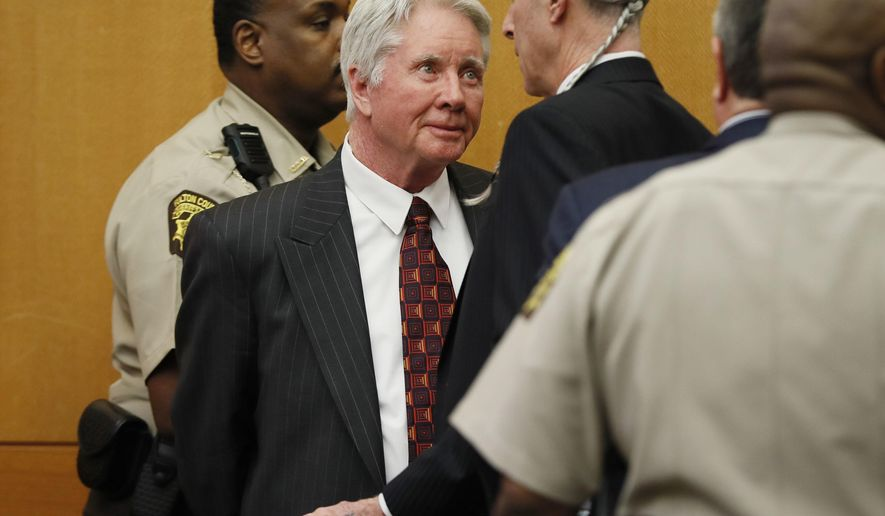 Tex McIver has a word with defense attorney Bruce Harvey as he is taken into custody after a jury found him guilty of murder and influencing witnesses on their fifth day of deliberations Monday, April 23, 2018 at the Fulton County Courthouse in Atlanta. (Bob Andres/Atlanta Journal-Constitution via AP, Pool)