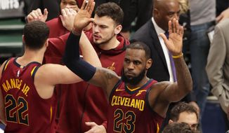 Cleveland Cavaliers forward LeBron James (23) celebrates following Game 4 of an NBA basketball first-round playoff series against the Indiana Pacers in Indianapolis, Sunday, April 22, 2018. The Cavaliers defeated the Pacers 104-100. (AP Photo/Michael Conroy)