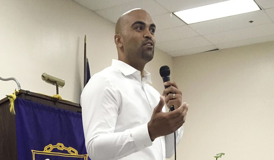 In this April 7, 2018 photo, Democratic congressional candidate Colin Allred, a former NFL linebacker and civil rights attorney, addresses a town hall in Dallas. The area has for years embodied country club Republicanism, but Allred is hoping that changing demographics and an electorate becoming better educated can help him upset longtime Republican Rep. Pete Sessions. If Democrats are going to retake the House in November, they may have to win in some unlikely places: Sessions' Dallas district, and similar Republican-held territory in Houston, Miami, Southern California and Cincinnati. (AP Photo/Will Weissert) **FILE**