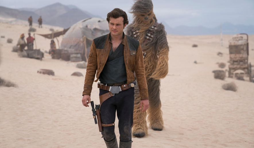 """In this image released by Lucasfilm, Alden Ehrenreich and Joonas Suotamo appear in a scene from """"Solo: A Star Wars Story,"""" in theaters on May 25. (Jonathan Olley/Lucasfilm via AP)"""