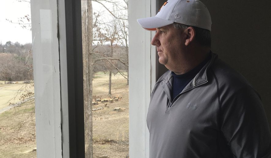 In this March 9, 2018 photo, Marshall County resident Jeff Dysinger looks out a window in Benton, Ky. Dysinger's daughter, Hannah, was injured by gunfire in the shooting at Marshall County High School on Jan. 23, but Dysinger, who owns an AR-15 rifle, is opposed to further gun reforms. (AP Photo/Dylan Lovan)