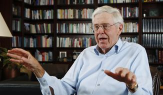 FILE - In this May 22, 2012, file photo, Charles Koch speaks in his office at Koch Industries in Wichita, Kan. A sure sign of policy success for the sprawling conservative network funded by the billionaire Koch brothers is Democratic pushback. With regulations being rolled back and huge tax cuts, Democrats question how far the Koch network's influence extends. (Bo Rader/The Wichita Eagle via AP, File)