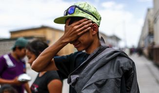 A young Central American migrant who attended the annual Migrants Stations of the Cross caravan for migrants' rights cries after arriving by train to Hermosillo, Sonora state, Mexico, Saturday, April 21, 2018. The remnants of the migrant caravan that drew the ire of President Donald Trump were continuing their journey north through Mexico toward the U.S. border. (AP Photo/Luis Gutierrez)