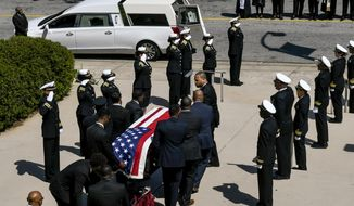 A casket bearing CDC researcher Timothy Cunningham is carried past a CDC honor guard during a memorial service held at Morehouse College Saturday, April 21, 2018, in Atlanta. Cunningham was found drowned in the Chattahoochee River after going missing for seven weeks however a medical examiner found no evidence of foul play. (John Amis/Atlanta Journal-Constitution via AP)