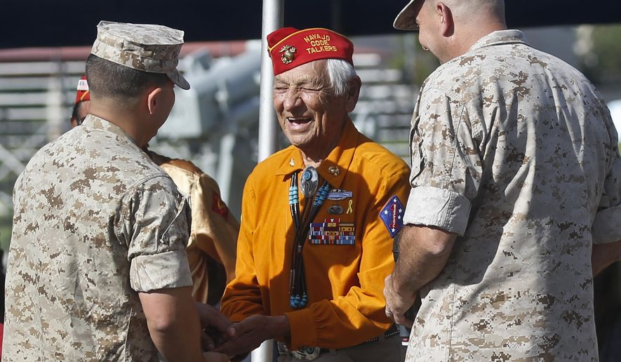 FILE - In this Sept. 28, 2015, file photo, former United States Marine and Navajo Code Talker Roy Hawthorne Sr., center, talks with Marines including Major Gen. Daniel O'Donohue, right, at a ceremony honoring the code talkers and their contributions to the U.S. war effort in World War II, at Camp Pendleton, Calif. The Navajo Nation says Hawthorne Sr. died Saturday, April 21, 2018. He was 92. Hawthorne enlisted in the U.S. Marine Corps at age 17 and became part of a famed group of Navajos who transmitted hundreds of messages in their language without error. The code was never broken. (AP Photo/Lenny Ignelzi, File)