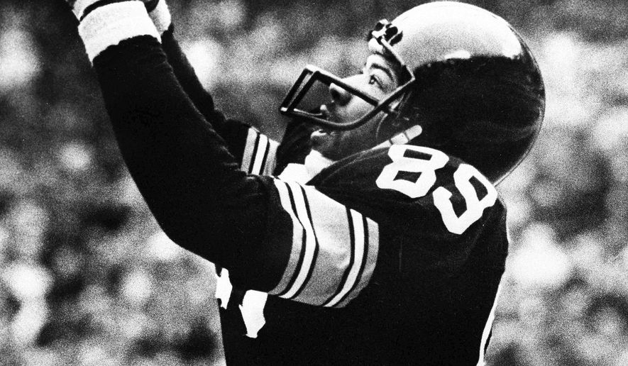 FILE - In this Jan. 6, 1980, file photo, Pittsburgh Steelers' Bennie Cunningham (89) leaps to catch a Terry Bradshaw pass in the end zone for a touchdown in the second period of the AFC championship game against the Houston Oilers, in Pittsburgh. Bennie Cunningham, a versatile tight end who starred at Clemson and won two Super Bowls with the Pittsburgh Steelers, has died. He was 63. The university says he died of cancer Monday, April 23, 2018, at the Cleveland Clinic. (The New York Times via AP, File)