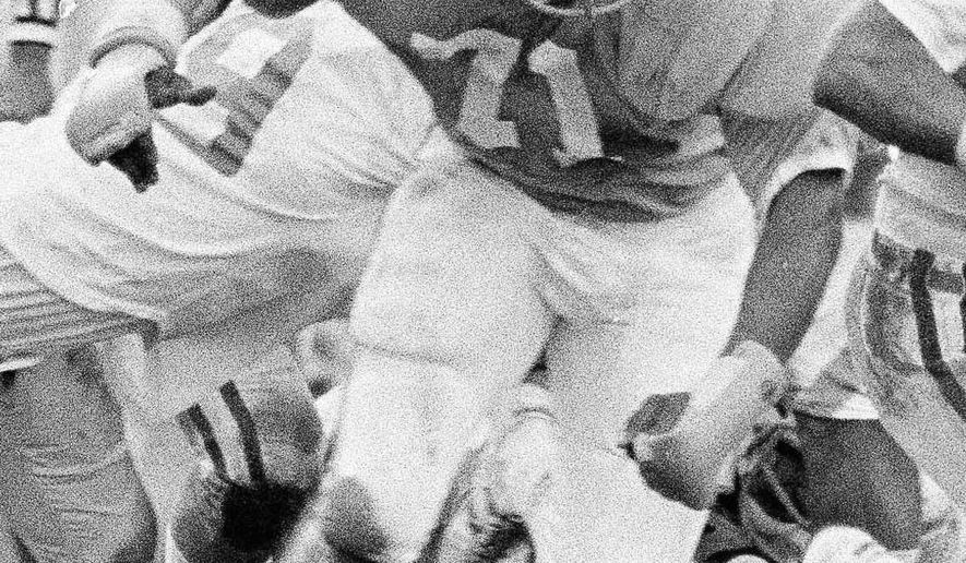 FILE - In this Dec. 31, 1976, file photo, North Carolina's Dee Hardison (71) is shown during the Peach Bowl college football game against Kentucky, in Atlanta. Former North Carolina defensive tackle Dee Hardison, a member of the North Carolina Sports Hall of Fame who played 11 seasons in the National Football League, has died. He was 61. Tim Butler of Butler & Son Funeral Home in Clinton confirmed that Hardison died on Saturday at UNC Hospitals in Chapel Hill, where he had been hospitalized for several weeks. (AP Photo/File)