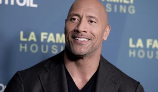 """FILE - In this April 5, 2018 file photo, Dwayne Johnson attends the 2018 LA Family Housing Awards in West Hollywood, Calif. Johnson announced the birth of his third daughter Monday, April 23, on Instagram. He showed off a chest full of tattoos in a hospital snap with his latest addition, Tiana Gia Johnson. It's his second daughter with partner Lauren Hashian. He also has a 16-year-old daughter with his former wife, Dany Garcia. He said Hashian labored like a """"rock star."""" (Photo by Richard Shotwell/Invision/AP, File)"""