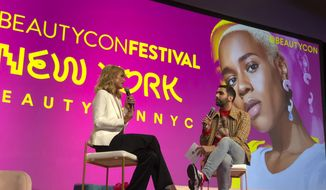 This April 21, 2018 photo shows Paris Hilton, left, appears with moderator Phillip Picardi during the beauty industry event Beautycon Festival NYC in New York. Hilton said that she regrets saying pre-election that women who accused President Donald Trump of sexual misconduct were merely after fame and attention. (AP Photo/Leanne Italie)